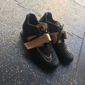 Black and gold Nike Romelaos